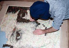 Illustrator Ed Fairburn draws stunning large-scale portraits on maps...
