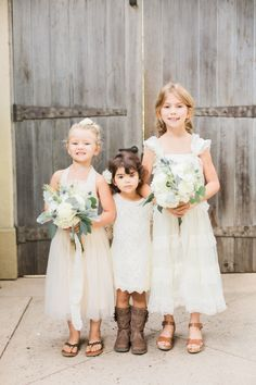 The cutest trio of flower girls: http://www.stylemepretty.com/little-black-book-blog/2016/02/03/rustic-elegant-fall-wedding-at-chateau-st-jean/ | Photography: Koman Photography - http://komanphotography.com/