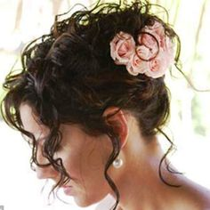 Bride's messy updo bun curly bridal hair ideas Toni Kami Wedding Hairstyles ♥ ❶ Pink rose accents Romantic