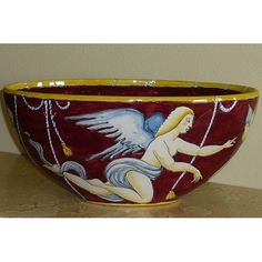 Vaso ovale con riproduzione disegni Gio Ponti primi '900.Questo oggetto è rigorosamente e abilmente fatto e pitturato a mano da Maestri Artigiani di Montelupo, e pertanto appare unico nei suoi particolari.