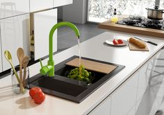 Kitchen with green mixer, Deante.