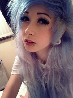 pastel purple hair i like the piercings on her face especially those by her eye