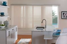 Sliding panel track shades are a great solution for covering long windows.
