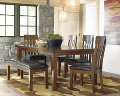 Fall in love with the Ashley Ralene Medium Brown 7 Pc. Rectangular Dining Room Butterfly Extension Table & 6 Upholstered Side Chairs by Signature Design by Ashley by Lakeland Furniture & Mattress proudly serving Minocqua, WI and surrounding areas! Upholstered Dining Bench, Dining Room Bench, Dining Room Sets, Dining Area, Chair Bench, Bench Set, Table Bench, Formal Dining Set, 5 Piece Dining Set