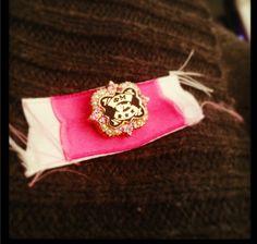 Phi Mu badge with ribbons