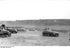 SdKfz. 250, SdKfz. 250/4, and SdKfz. 251 halftrack vehicles with Panzer II tanks in Southern Russia, 21 Jun 1942