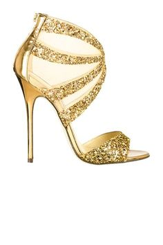 Strappy gold heel with glitter and mesh. When prom season rolls around, I will be reccomending these babies for anyone scouting for a simplistic burgundy dress! I love the pairing of gold and a deep red.   Jimmy Choo