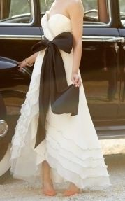 Gown with dramatic black sash - perfect for a monochrome wedding theme