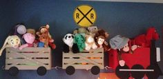 This is a train shelf I made for my son's big boy room last year.  He was 4 and moving out of a nursery :) he was really into Thomas at the time but I still love this as it holds all of his stuffed animals so well!