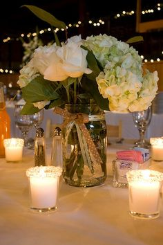 INSPIRATION: Spring Mason Jar Centerpieces - Project Wedding Forums ( Now if only we can translate this to a fall thene. with red roses instead. Mason Jar Centerpieces, Mason Jar Diy, Wedding Centerpieces, Wedding Table, Rustic Wedding, Our Wedding, Dream Wedding, Wedding Decorations, Wedding Ideas
