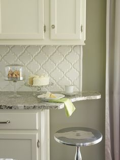 Suzie: Cote de Texas - Creamy white kitchen cabinets with Bianco Antico Granite countertops ...