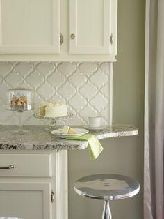 Suzie: Cote de Texas - Creamy white kitchen cabinets with Bianco Antico Granite countertops ...