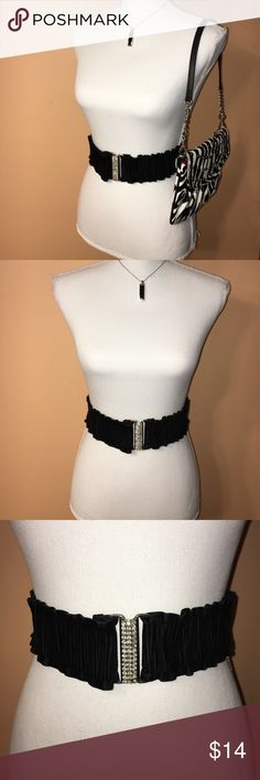 "Black & Rhinestone Belt Black & Rhinestone Belt, stretchy and hooks together for easy wear. One Rhine stone is missing and black material is loose in one spot. Measures 27"". Super cute and pairs perfectly with a white Cotton dress and zebra handbag. Accessories Belts"