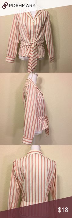 """Jones New York Pink Striped Peplum Button-Up Top Size M.  Excellent like-new condition.  Hidden button-up front.  Unique front waist tie.  Button cuffs.  Length shoulder to hem: 21"""".  Bust: 40"""".  Waist: 38"""".  Bottom of shirt: 40"""" around.  Sleeve length: 23.5"""".  Cuff width: 4"""".   50% cotton, 36% polyester, 14% rayon.  Machine wash cold.   Love it but not the price - I'm open to (reasonable) offers or consider bundling 2 or more items for an additional 15% off and combined shipping!    Check…"""