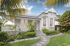 Lovely verandah and pathway at this Queenslander house. I also love the exterior paint scheme.