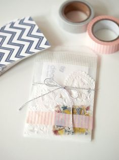 business card in a tiny vellum bag (also called glassine) embellished with cute things