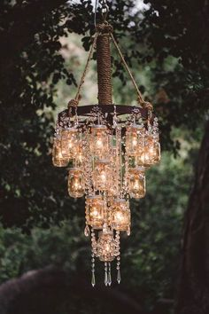 Vintage Wedding Ideas with the Cutest Details Beautiful mason jar chandelier! The post Vintage Wedding Ideas with the Cutest Details appeared first on Dome Decoration. Chandelier Wedding Decor, Mason Jar Chandelier, Wagon Wheel Chandelier, Diy Chandelier, Mason Jar Lighting, Outdoor Chandelier, Wedding Lanterns, Pendant Lamps, Gazebo Wedding Decorations