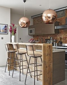 Rustic kitchen, copper pendants.