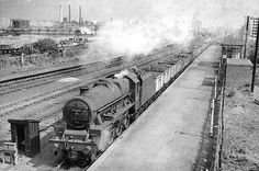 Ex-LMS 5XP 4-6-0 No 45668 'Madden' passes through Bromford Bridge station with a mineral train on 5th September 1962