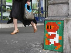 Who don't know space invaders??? Invader (born 1969) is a French urban artist who pastes up characters from and inspired by the 1978 arcade game Space Invaders game, made up of small coloured square mosaic tiles that form a space invader character mural. He does this in cities across the world !!!! All other the world, he is there!!! ;)