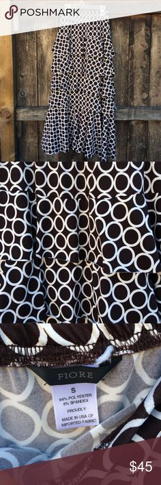 """Layered Skirt Dark Brown layered skirt. Gently worn. Size small but can fit larger due to the stretchy fabric. 94% polyester and 6% spandex. Length is 33.5"""" and waist is 11"""" across unstretched. Any questions? Please ask. I'm open to offers and I ship Same day.❌NO TRADES❌ Fiore Skirts"""