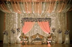 Lovely peach and gold wedding stage with flowers, lights Wedding Stage Design, Wedding Stage Decorations, Wedding Themes, Wedding Designs, Desi Wedding Decor, Marriage Decoration, Church Decorations, Light Decorations, Wedding Mandap