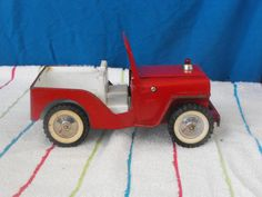 I had a blue Tonka jeep like this one for my Liddle Kiddles.