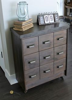 Like the paint, butcher block, wheels ~ DIY Apothecary Cabinet Ikea Rast Hack