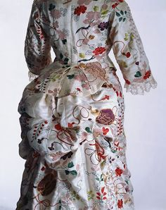 """Bustle detail, 1870s silk bustle dress is a success due to its reliance on Japonisme in the form of a kimono jacket and underskirt. Indeed, it is of interest as we are told that an actual kimono was incorporated to fashion the dress, rather than the more anticipated use of a kimono as fashionable """"at-home"""" wear.  From the Kyoto Costume Institute, """"Fashion: A History from the 18th to the 20th Century"""""""
