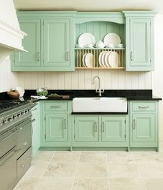 Mint green kitchen cabinets...I don't think I could do it, but it's really growing on me!