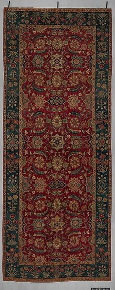 Carpet with Scrolling Vines and Blossoms  /  Carpet with Scrolling Vines and Blossoms Object Name: Carpet Date: ca. 1650 Geography: Northern India or Pakistan, Kashmir or Lahore Culture: Islamic
