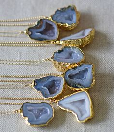 Open up a geode and magic happens as shiny little crystals emerge inside! Made with a raw agate occo geode with a sparkling druzy interior rimmed in 24k electroplated gold, suspended from a 14k gold f