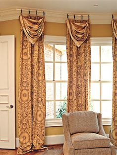 Love these drapes.  But don't like them hanging from the crown molding. But love the style.