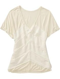 cream ruffle top - photo doesn't do it justice!  Just bought this @Old Navy yesterday on clearance and LOVE it!