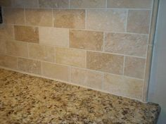 We selected a rich venetian gold granite with an simple yet elegant subway style travertine tile backsplash with pencil strips.                                                                                                                                                     More