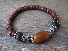 Womens boho tribal bracelet, horn, wood and metal, handmade from upcycled beads, natural materials, stretch bracelet