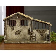 "The Holiday Aisle Stable Size: 9.63"" H x 15"" W x 4.25"" D"