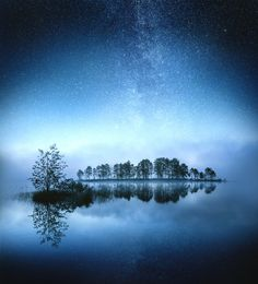 Dreamland, by Ilari Tuupanen... #Nightphotography #atmosphere #blue #clouds #fineart #finland #fog #foggy #lake #lights #longexposure #milkyway #mist #night #nightscape #reflection #sky #stars #summer #trees tuupanen water