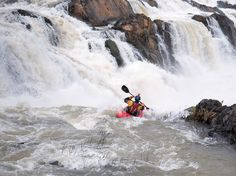 Picture of kayaker Chris Korbulic going over a waterfall on the Mekong River, Laos