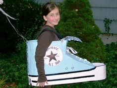 hi-top converse sneaker halloween costume.. used: Banker's Box, paint, thick black Sharpie, double sided rug tape, paper mache (to round the sneaker front & back), silver grommets (16), white twill tape (laces), white paper for logo, suspenders, cloth to cover tongue