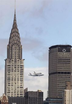 The prototype space shuttle Enterprise rides atop a modified 747 carrier jet over New York City on April 27. The Enterprise eventually will be put on display at the Intrepid Sea, Air and Space Museum in New York