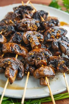 Balsamic Garlic Grilled Mushroom Skewers 2 pounds mushrooms, sliced 1/4 inch thick 2 tablespoons balsamic vinegar 1 tablespoon soy sauce (or tamari) 3 cloves garlic, chopped 1/2 teaspoon thyme, chopped salt and pepper to taste marinate and grill