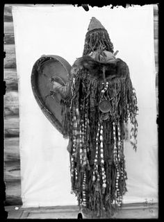 Yukaghir shaman in ceremonial dress [with drum], Siberia, Russia, 1902