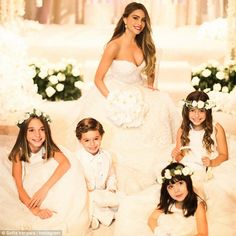 Impossibly romantic: Sofia posted this photo on Monday of herself surrounded by her three flower girls and her ring-bearer