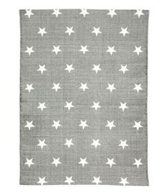 Gray. Rectangular rug in cotton fabric with printed star pattern at top and non-slip protection at back.
