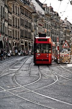 A tram approaches along one of Bern's Old City streets in Switzerland.  John & Tina Reid  |  Commercial Portfolio   |  Photography Blog   |  Travel Flickr Group