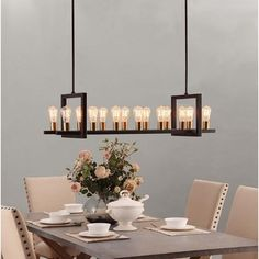 @Overstock - Griffin Rectangular 14-light Chandelier - Create a magnificent display of modern lighting architecture with this Griffin rectangular chandelier. The 14-light fixture includes Edison bulbs that provide the black minimal frame with vintage panache.  http://www.overstock.com/Home-Garden/Griffin-Rectangular-14-light-Chandelier/9316452/product.html?CID=214117 $242.99
