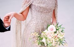 An impactful and fashion forward 2016 trend - the wedding cape dress.