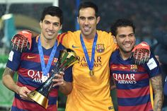 Luis Suarez, Claudio Bravo and Dani Alves of FC Barcelona celebrate with the trophy during the final match between River Plate and FC Barcelona at International Stadium Yokohama on December 20, 2015 in Yokohama, Japan.