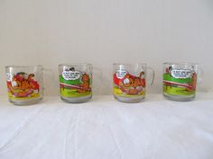 MCDONALDS GARFIELD CUPS - Set of Four from 1978 - garfield the cat and odie the dog by CellarDeals on Etsy